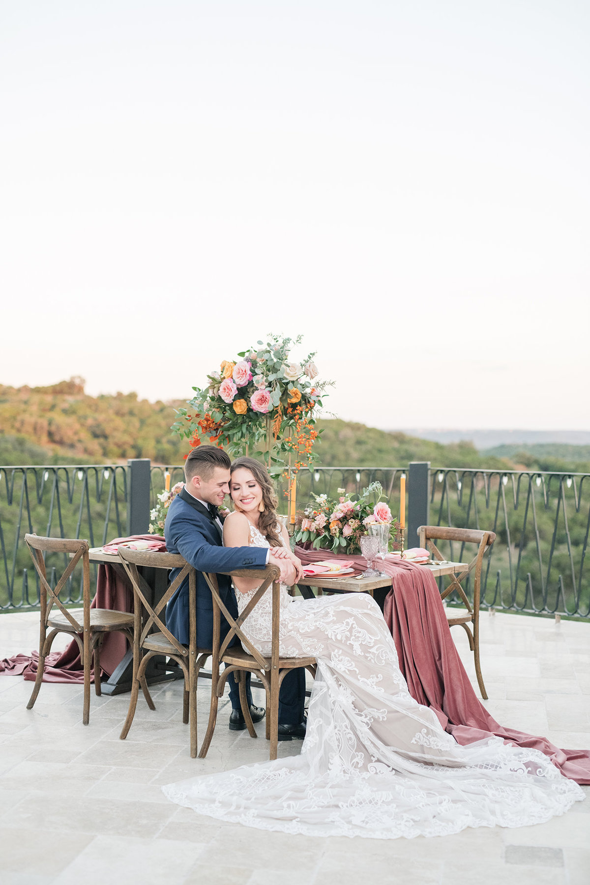 Bride and groom snuggle at fall wedding at Villa Antonia near Austin Texas