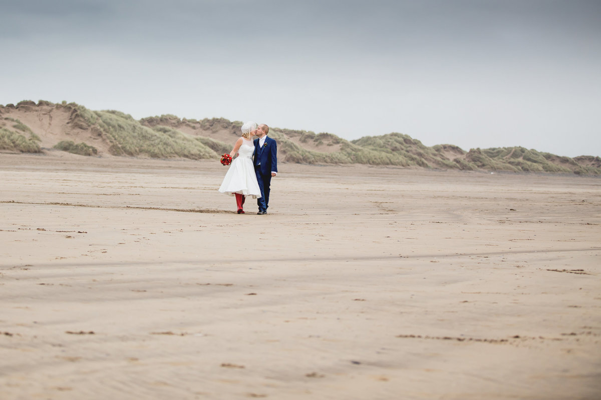 bride and groom on saunton sands beach