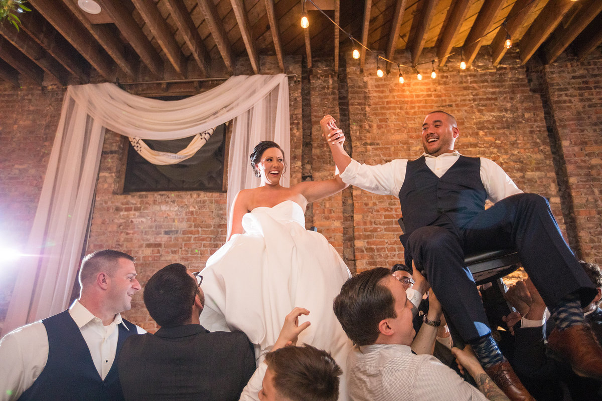 jewish chair dance with bride and groom at mercantile hall in burlington wisconsin