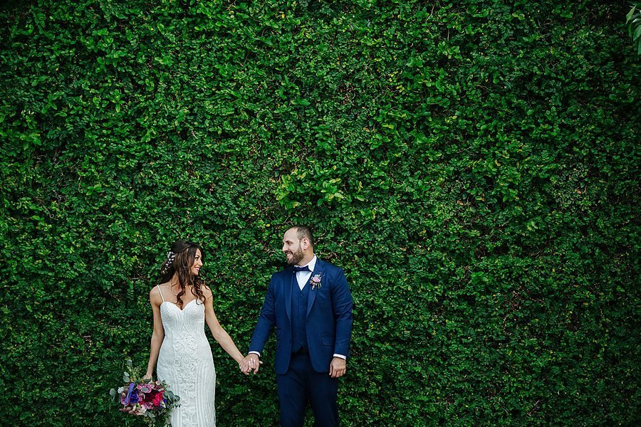 sundy house wedding, couple standing in front of ivy wall