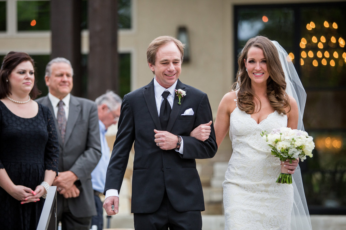 bride and dad walking down aisle in ceremony at remi's ridge at hidden falls wedding a