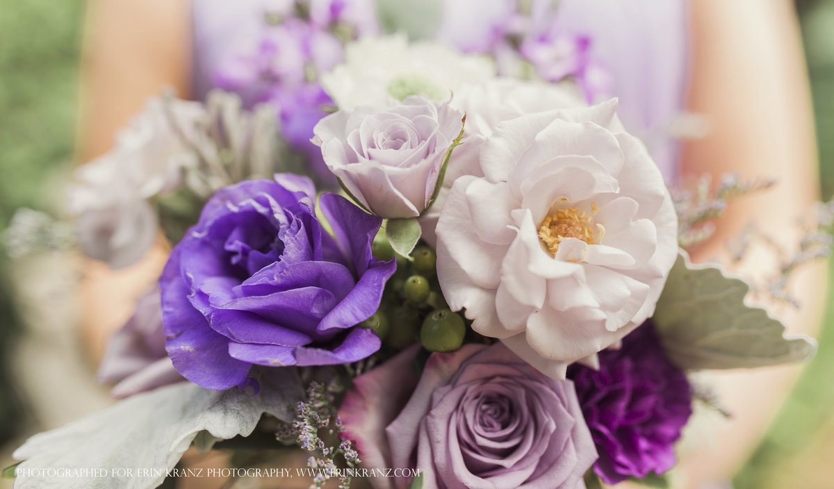 charlotte wedding photographer jamie lucido captures a beautiful detail of a wedding bouquet featuring purple and white florals