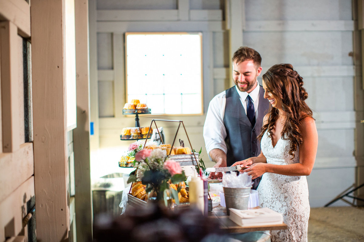 Strawberry-Creek-Ranch-Wedding-Ashley-McKenzie-Photography-Summer-love-on-the-ranch-Couple-cutting-the-cake