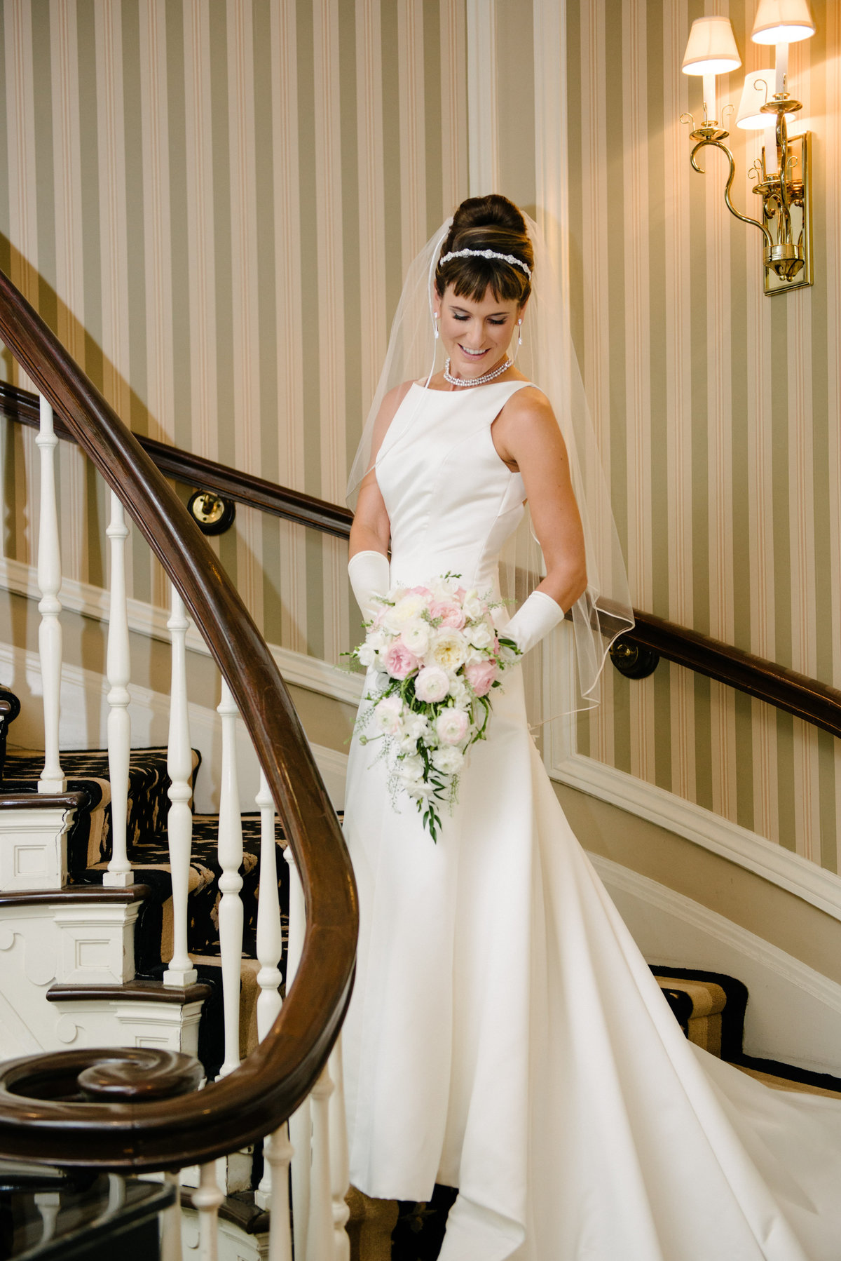 classic bridal portrait with bouquet and long gloves on curved staircase at madison club
