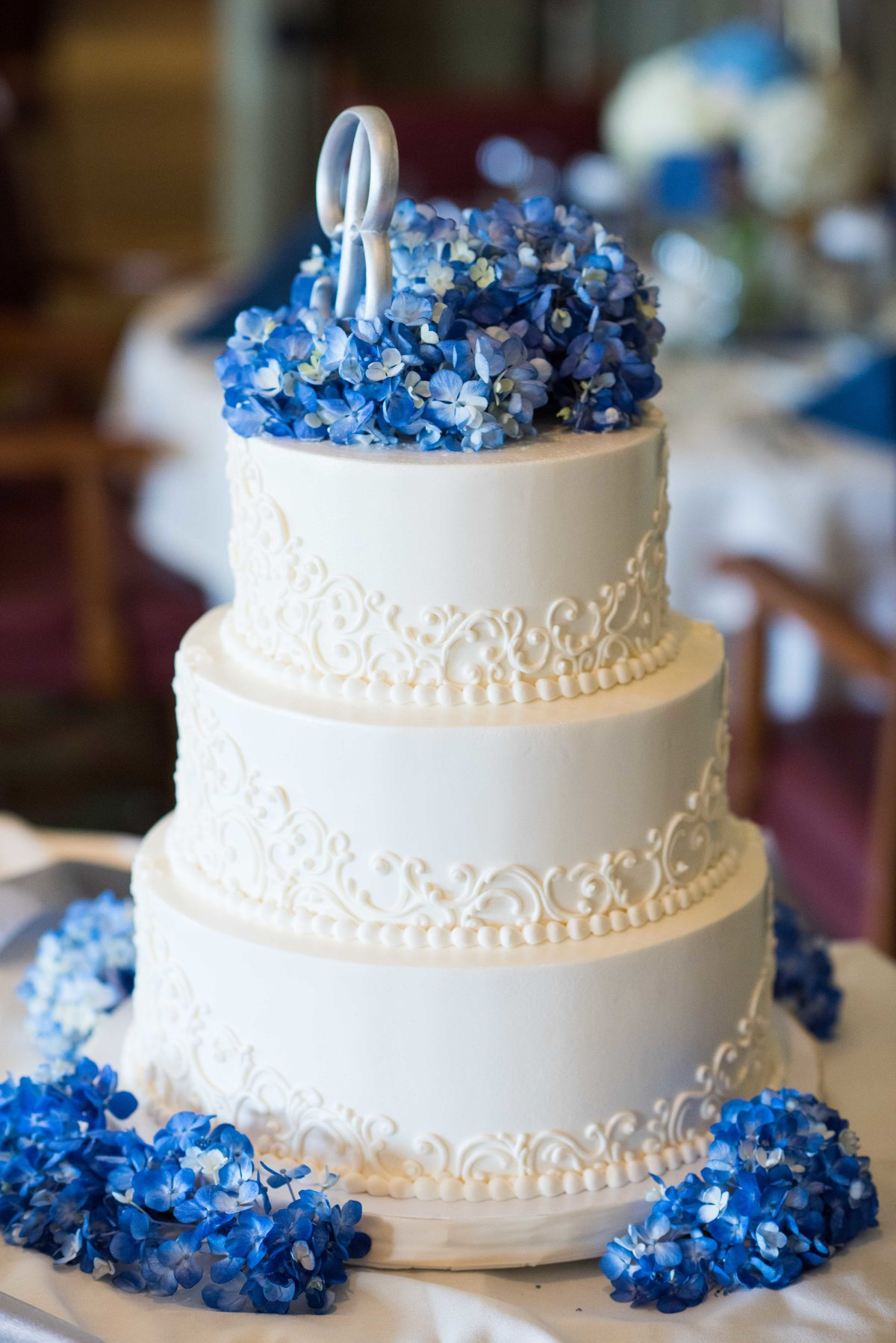 Wedding cake, blue flower highlights, Chicago wedding.