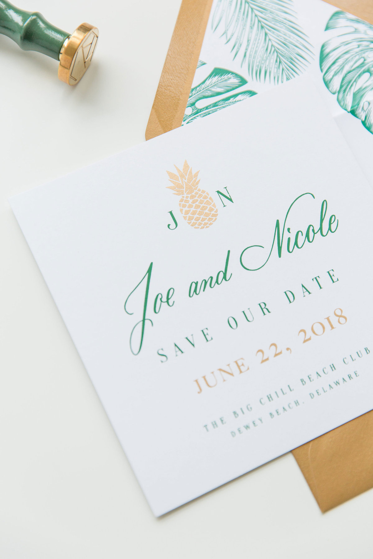 Tropical inspired save the date with custom hand lettering