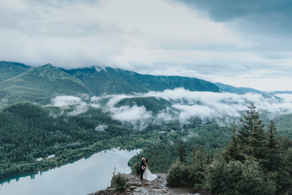 An elopement at Rattlesnake Ledge, a bride and groom embrace.