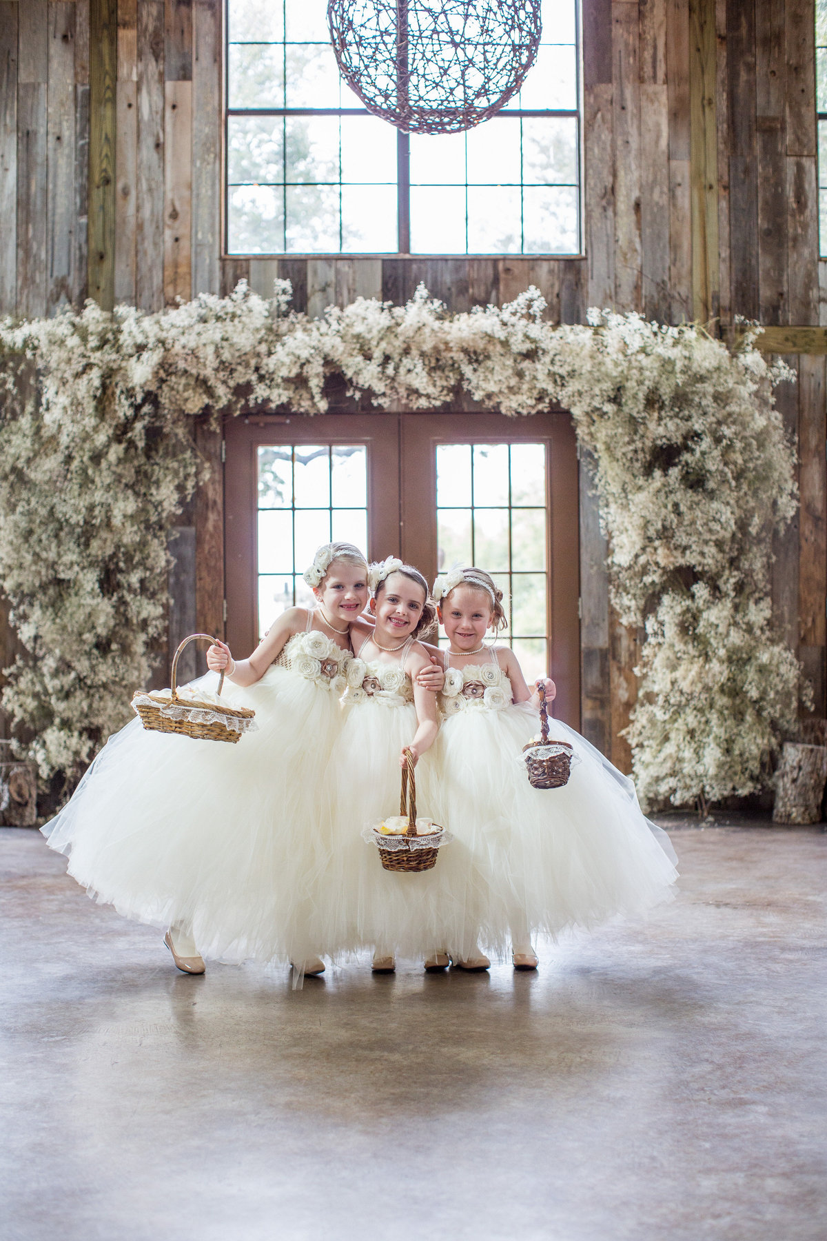 flower girls pose for portrait before wedding ceremony in Texas Hill Country wedding at Vista West Ranch