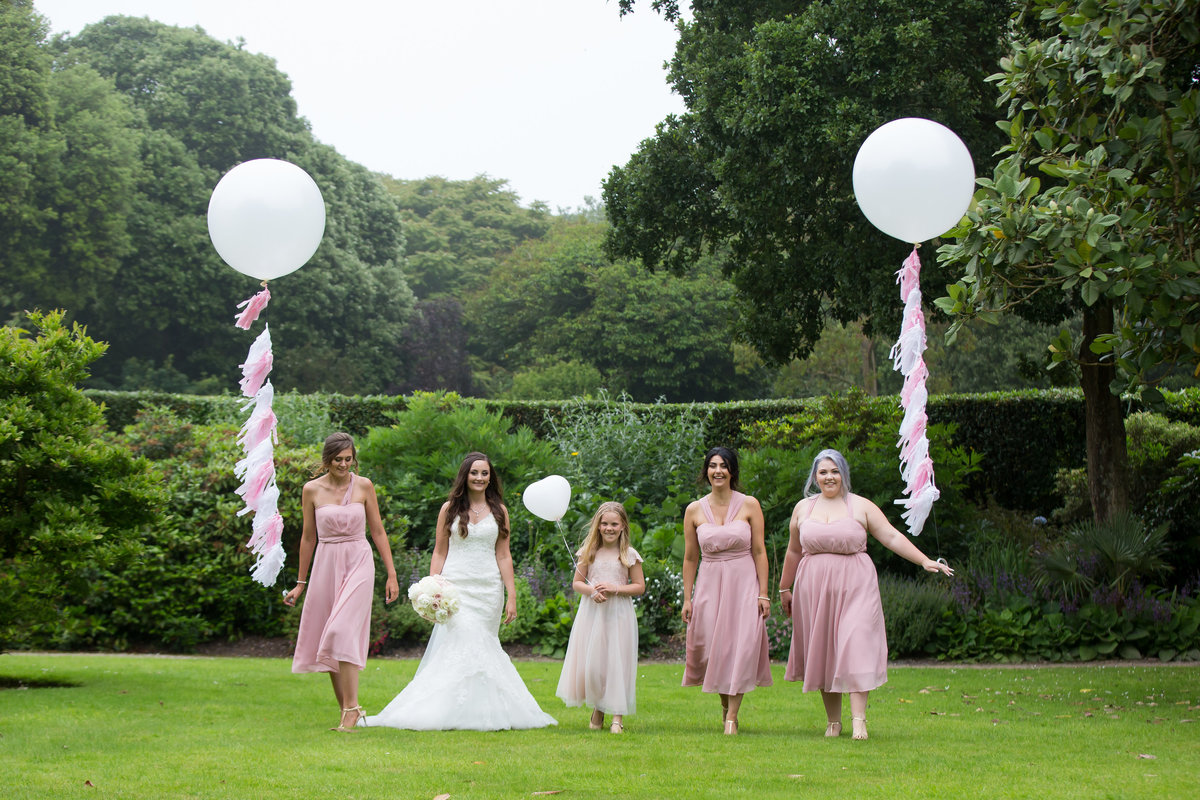 bride and bridesmaids with balloons in plymouth wedding