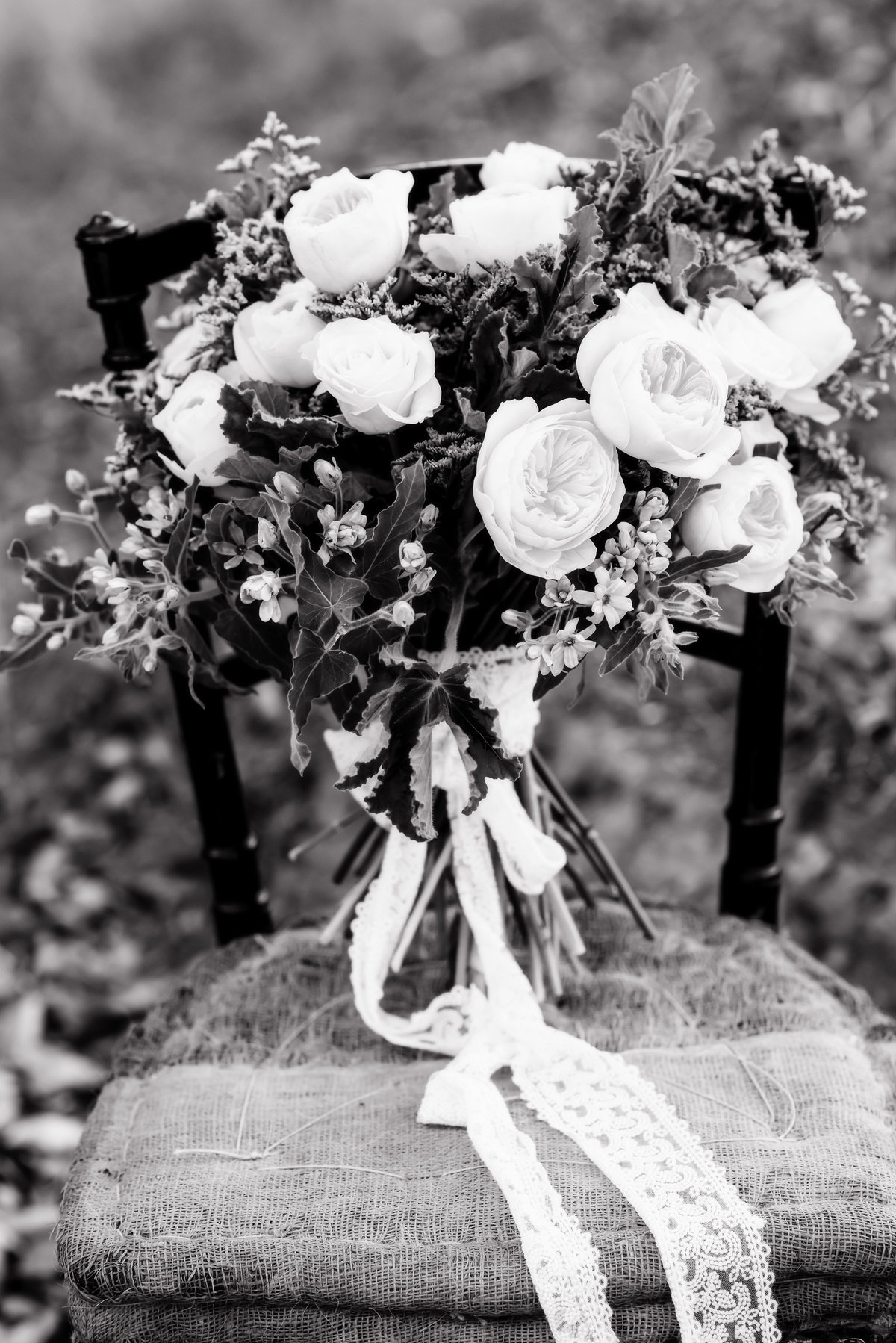 Black and white image of Wedding bouquet on vintage chair