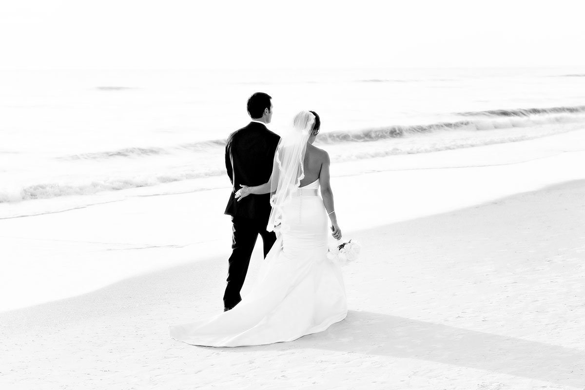 naples beach hotel and golf club wedding bride and groom walking
