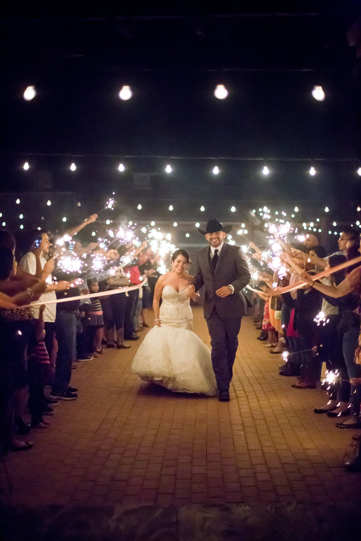 wedding sparkler exit with bride and groom at hoffman ranch wedding venue in castroville texas