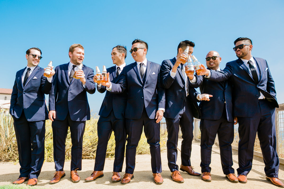 groom-groomsmen-celebrate-wedding-portrait