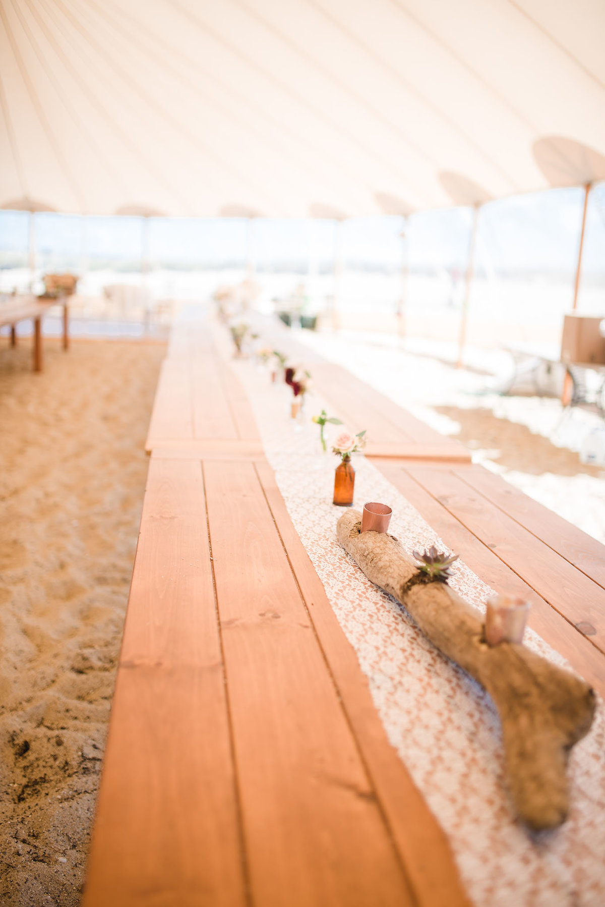 long tables at beach wedding, driftwood centerpieces