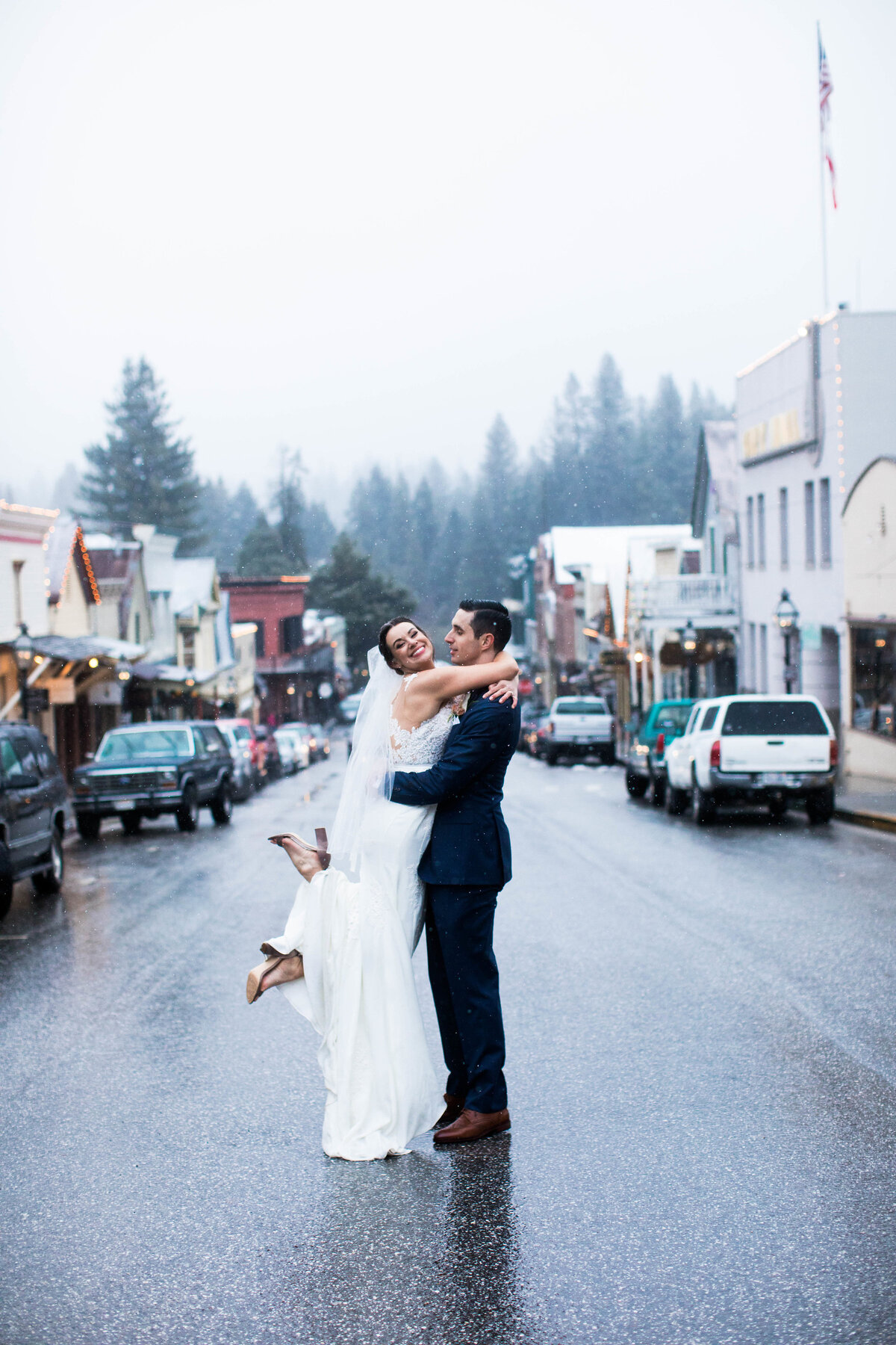 Bride and groom in the center of the street in Nevada City