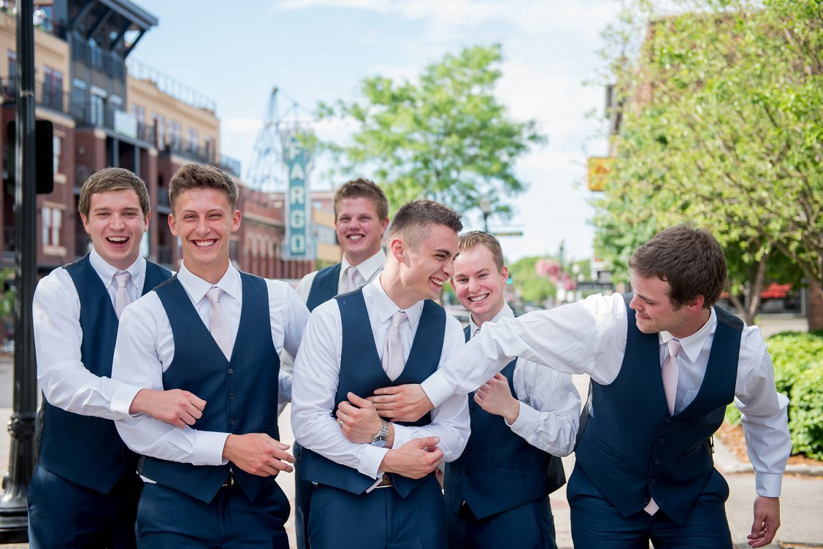 Kris Kandel photographed a lively bunch of groomsmen in downtown fargo