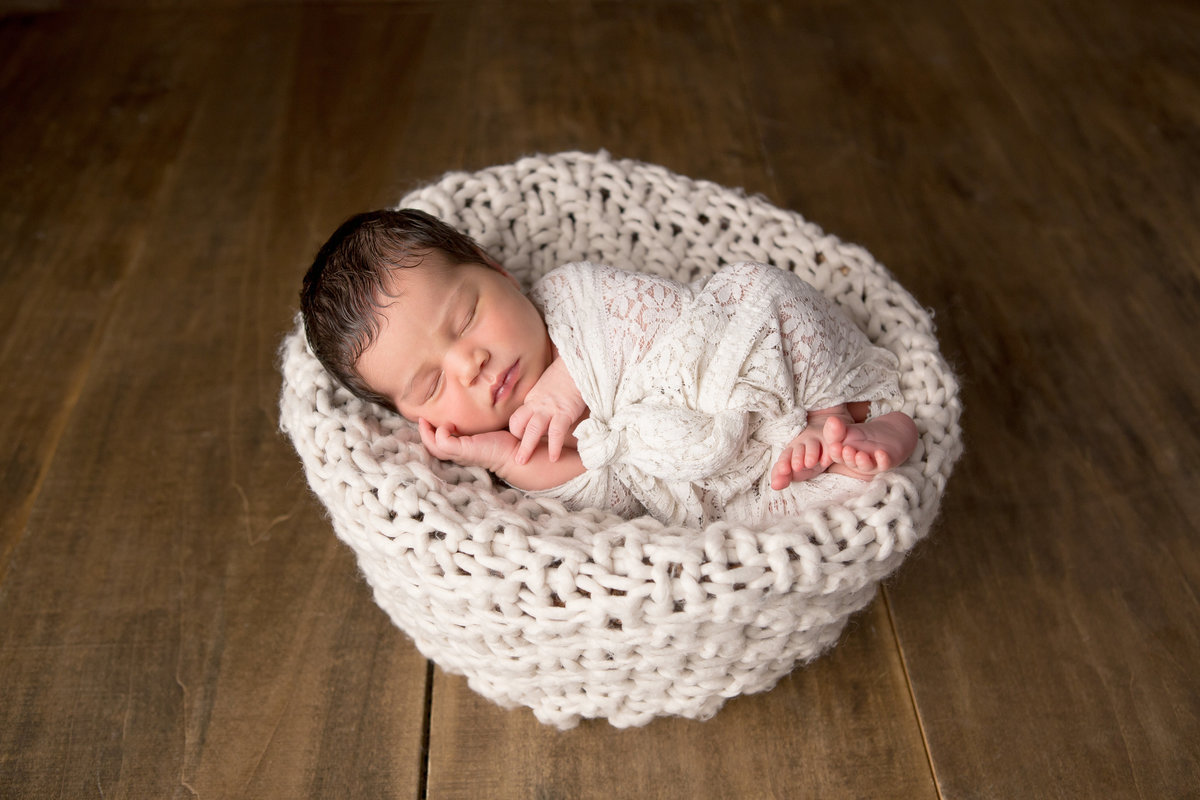 Hudson Valley newborn baby photography girl in knit basket with lace wrap and rustic wood by Cornwall NY photo studio photographer