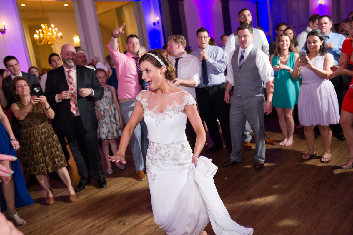 Bride dances in crowd at wedding reception, Chicago IL.
