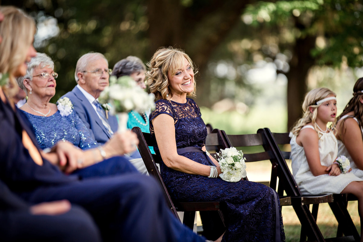 Mother of the bride watching the ceremony smiling at a plantation in Charleston, SC by Knoxville Wedding Photographer, Amanda May Photos.