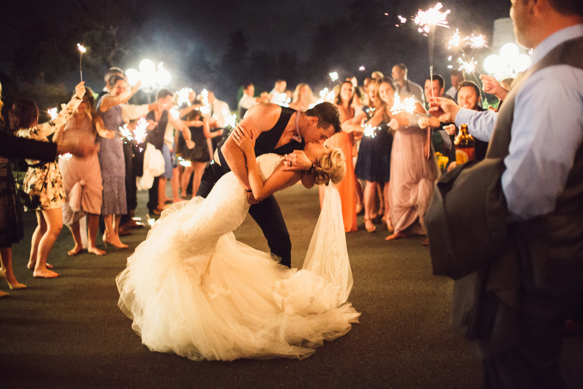 Groom dipping and kissing Bride during Sparkler Exit Bastyr Univeristy Chapel Hollywood Schoolhouse Woodinville