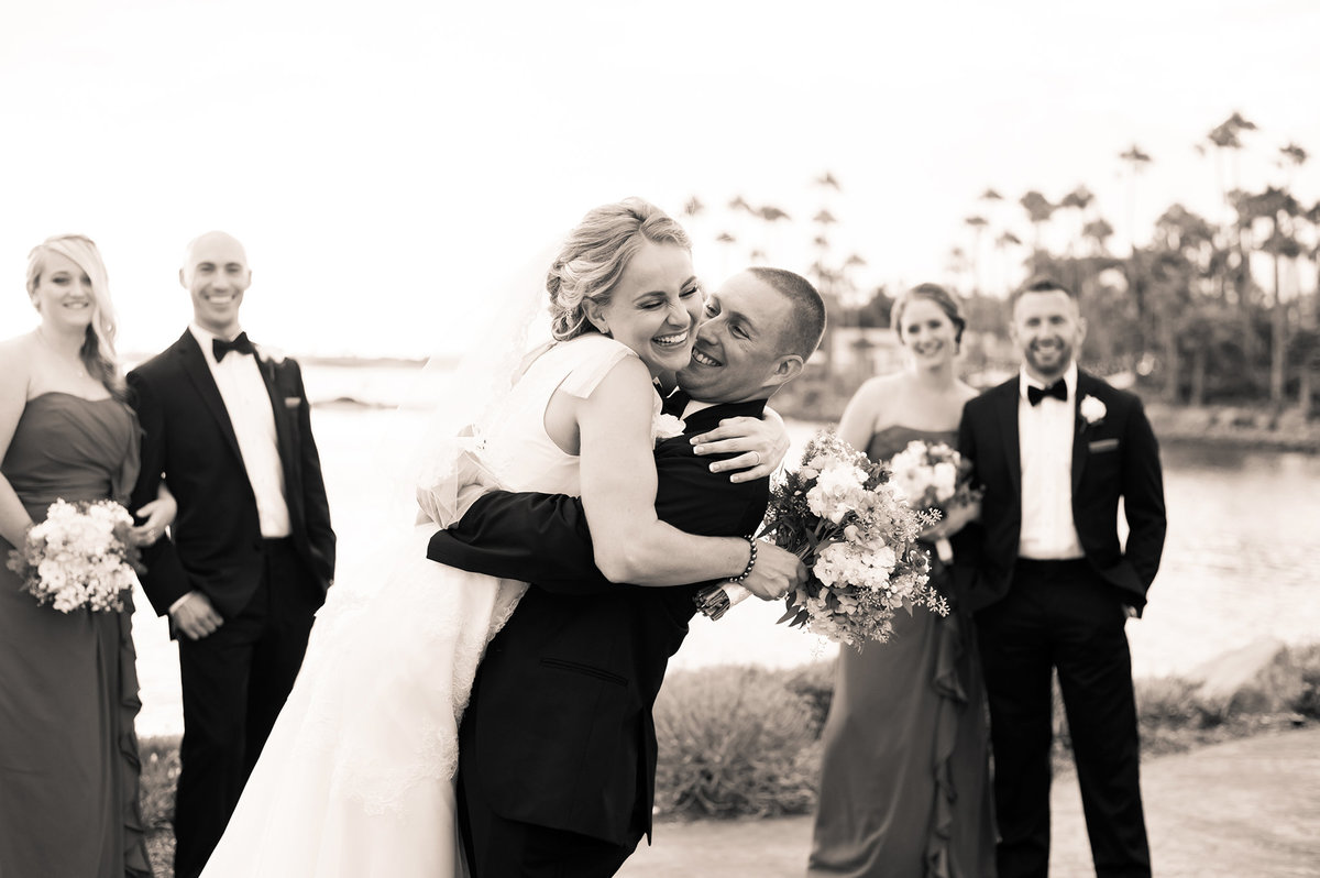 Groom-Gives-Bride-Heartfelt-Hug-with-Real-Emotion-Wedding-Photography-Paradise-Point-San-Diego-CA
