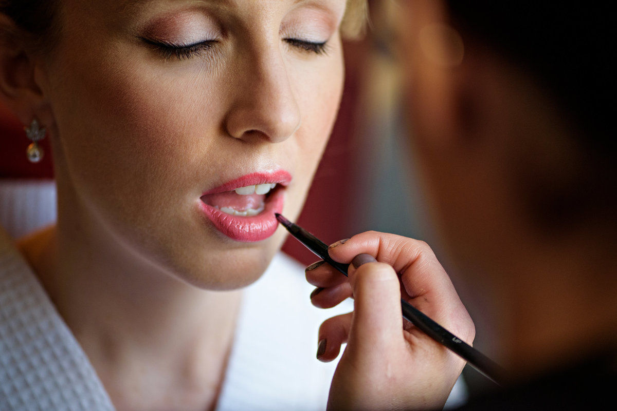 A bride getting her makeup done before her wedding at Hotel Monaco in Philadelphia, PA.