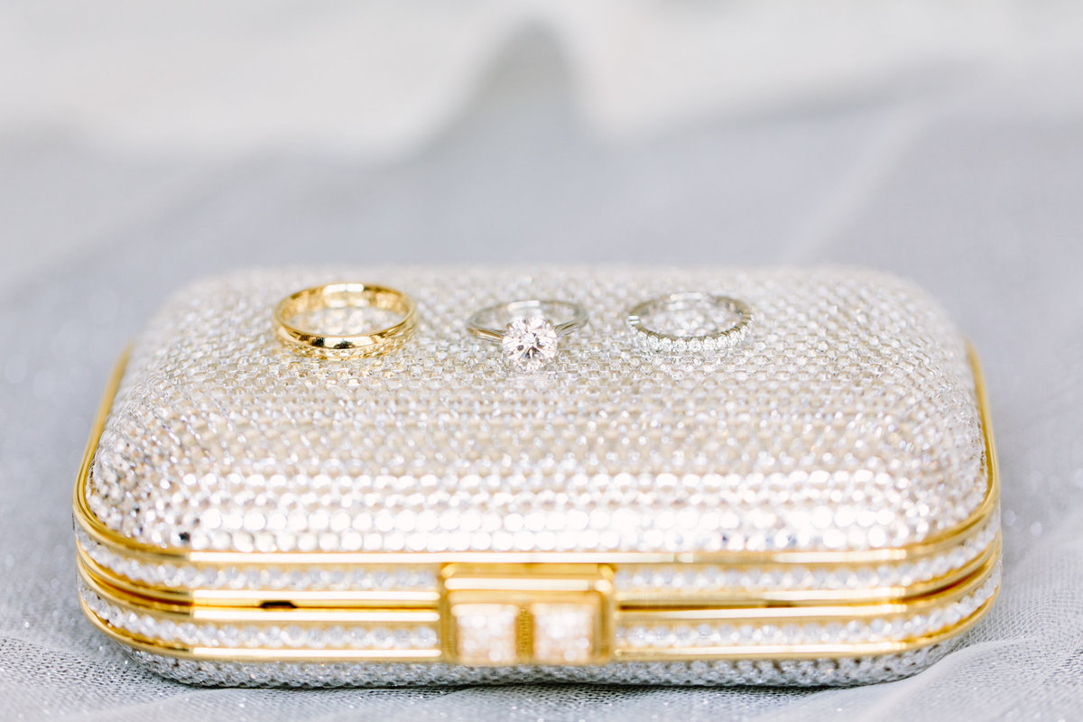 Sparkly clutch with wedding rings on top