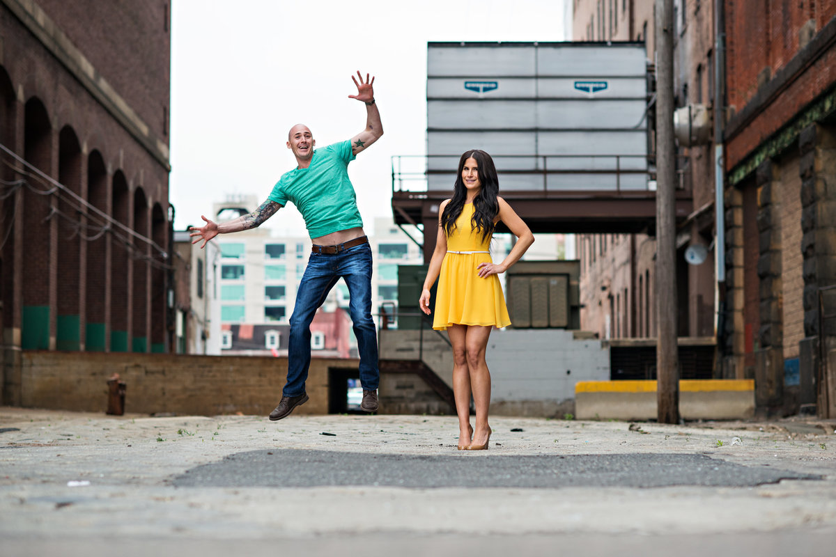 A sexy couple having fun in their engagement session.