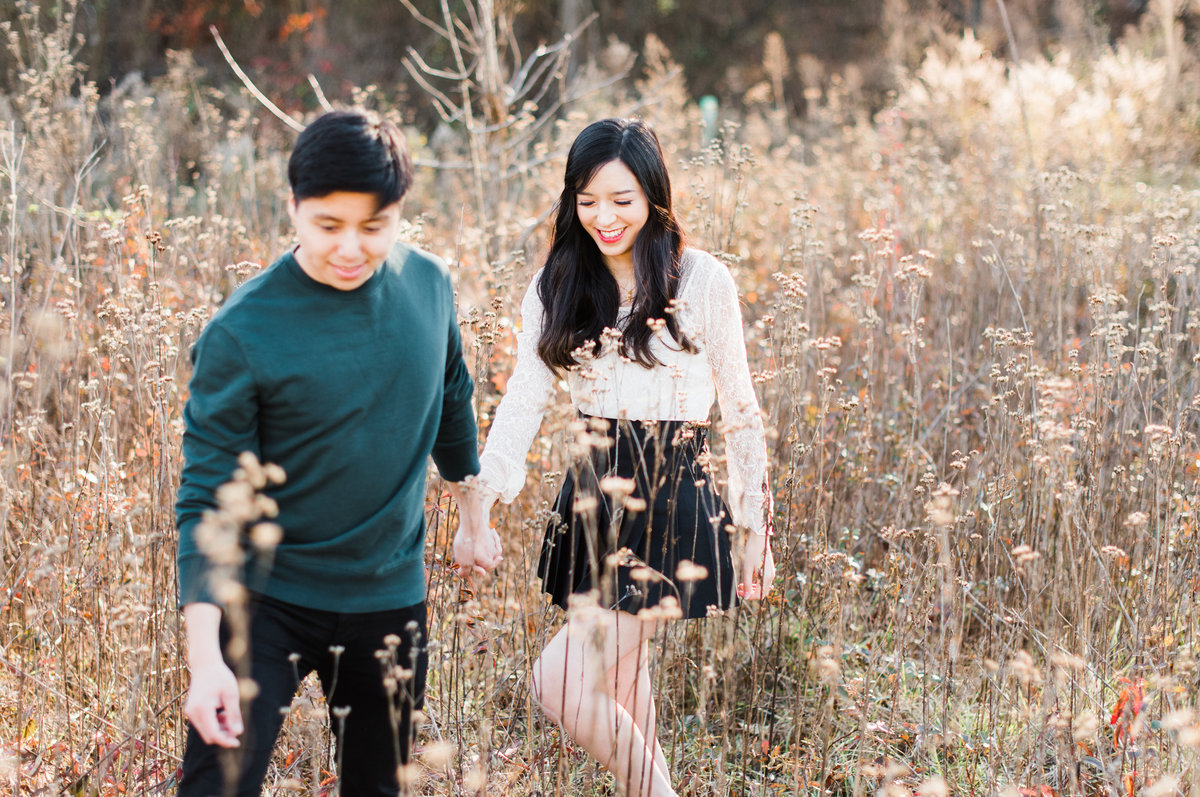 walking through a field engagement photo