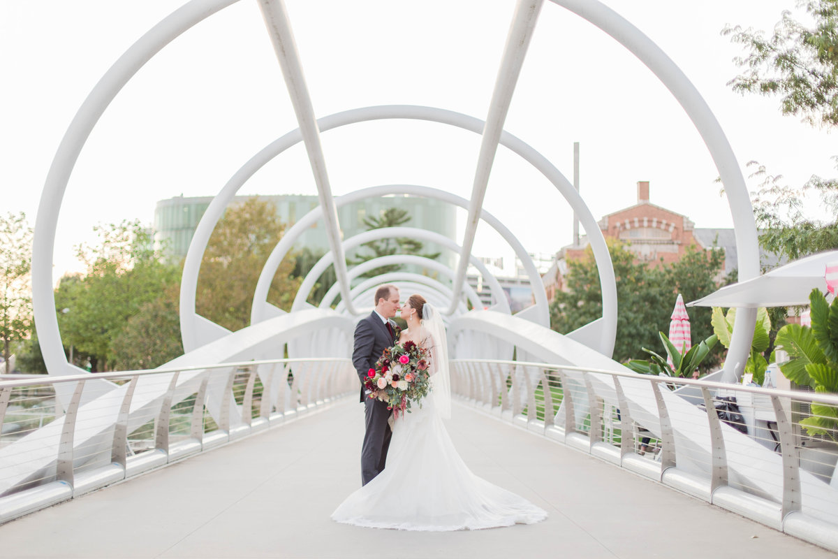 bride and groom on bridge at navy yard in washington dc by costola photography