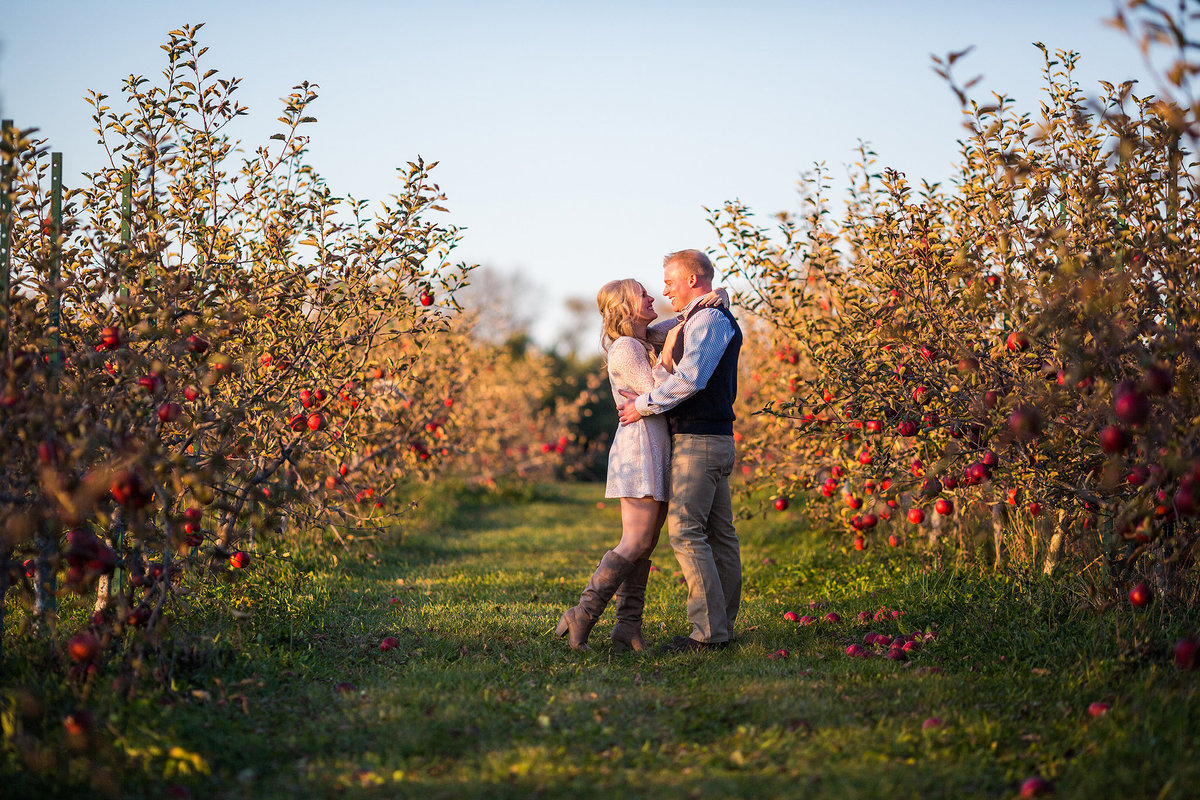 a fall engagement photography session with a couple in an orchard