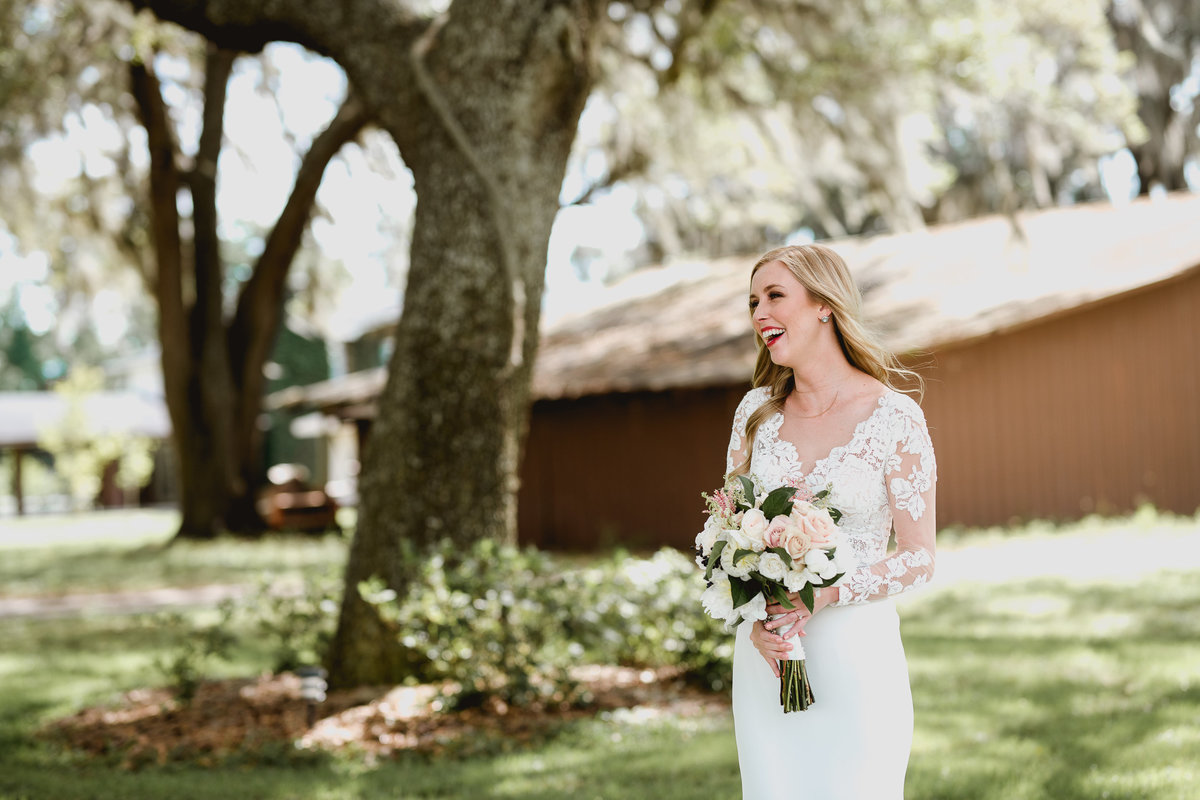 bride laughing on her wedding day in north florida