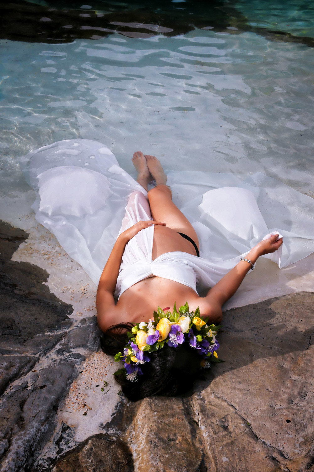 Glamourous pregnancy shot of mom-to-be lying on the beach. Photo by Ross Photography, Trinidad, W.I..