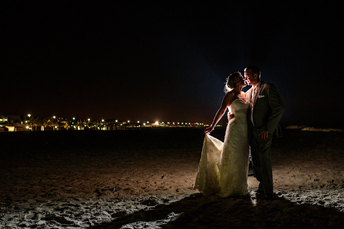A wedding couple pose for a night portrait after their long branch, NJ wedding.