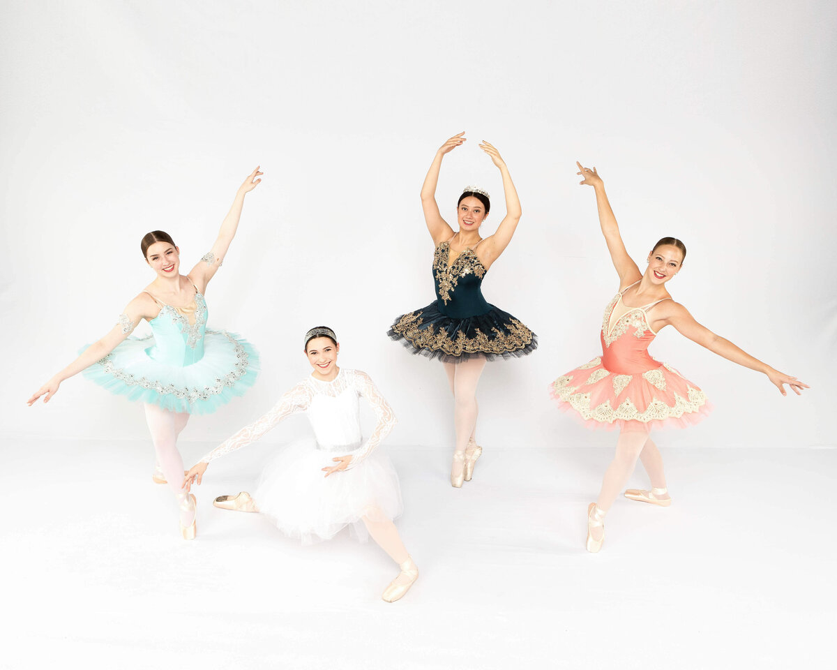 Four ballerinas in tutus