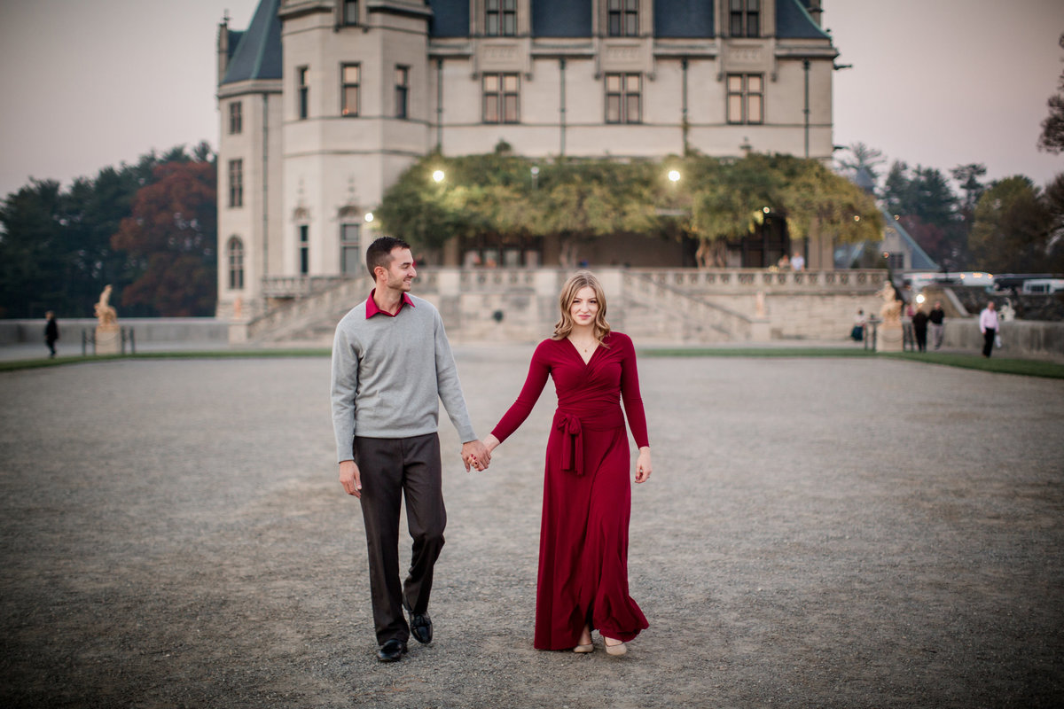 Walking toward the camera at The Biltmore engagement photo by Knoxville Wedding Photographer, Amanda May Photos.