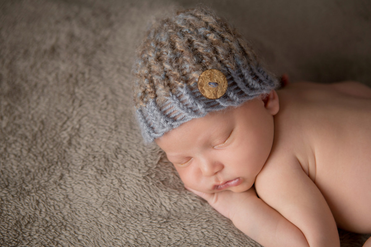 sleeping newborn infant boy wearing a knit hat simple close up Rockland County baby photography by Hudson Valley photographer Cornwall NY photo studio