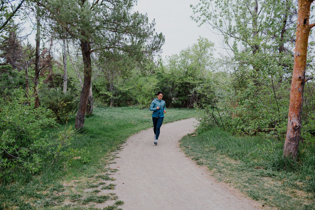 Woman runs on a path in the spring