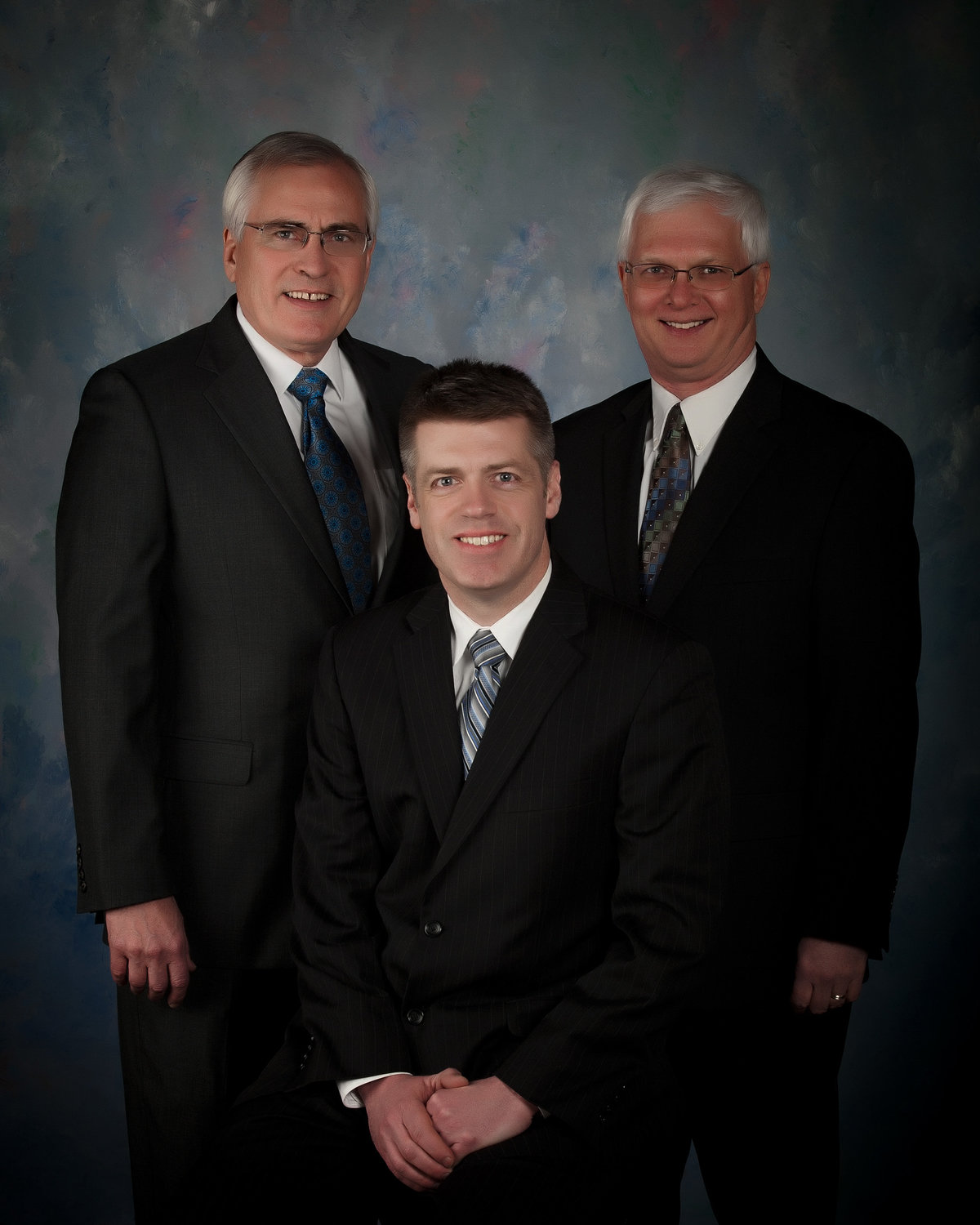 attorneys in group studio picture wearing suits