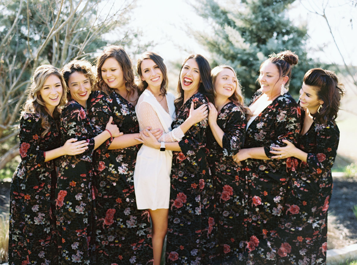 Bridesmaids just want to have fun. So much laughter from this wedding party! Just look at these gorgeous black floral robes for weddings
