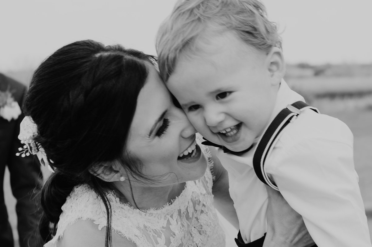 Bride laughing with her son after the ceremony.