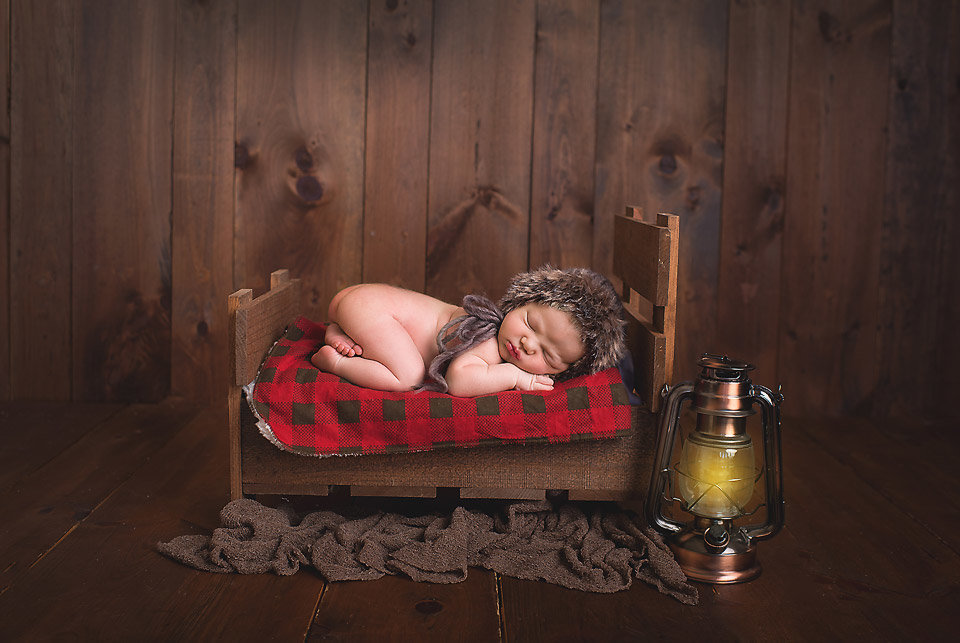 Newborn boy rustic wood bed camping CT newborn Photographer