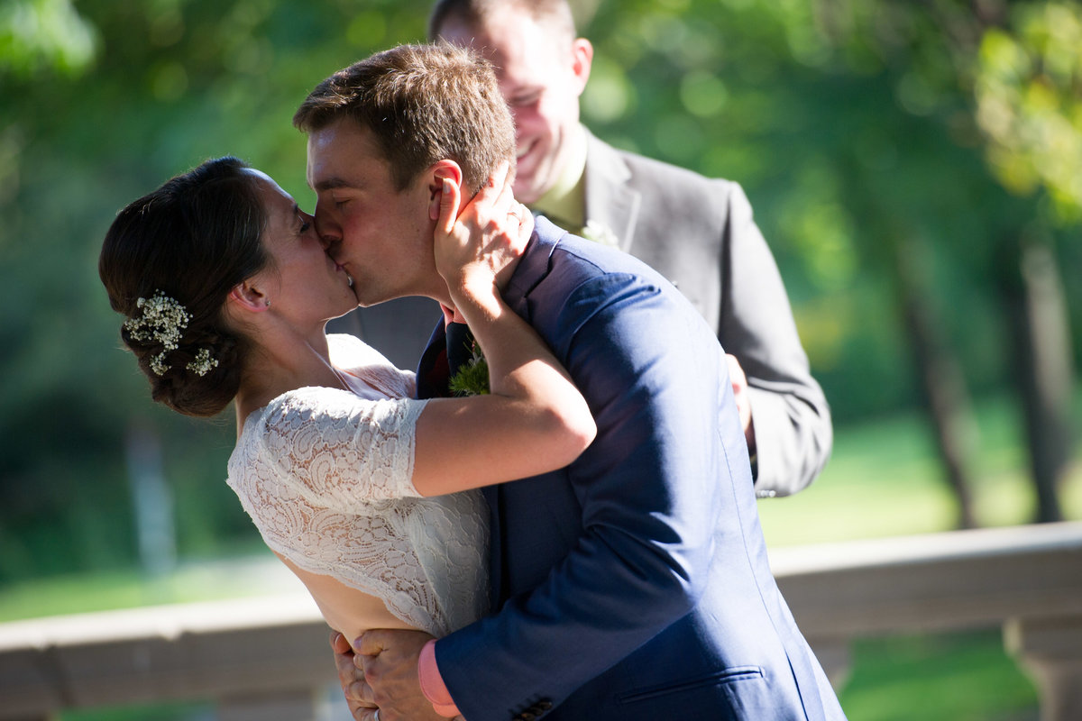 Bride and groom kiss at conclusion of ceremony, Chicago.