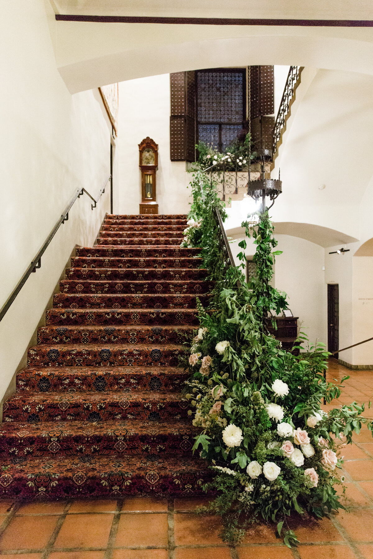 a long staircase decorated with flowers