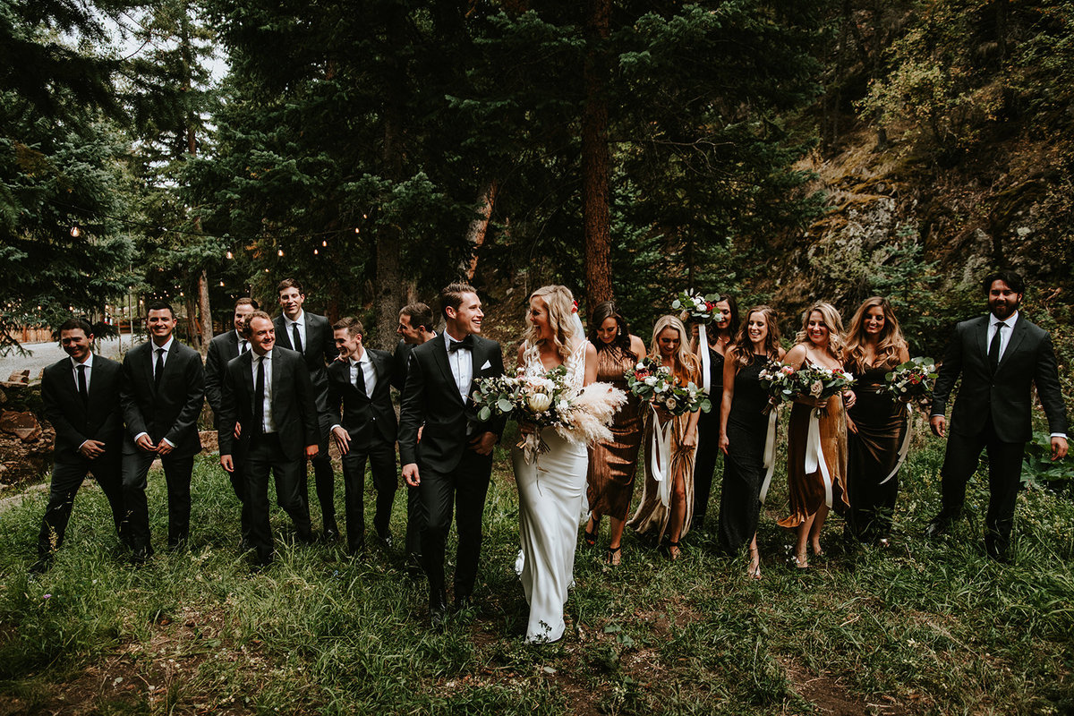 wedding party walking in a line at Blackstone Rivers Ranch in Idaho Springs, CO