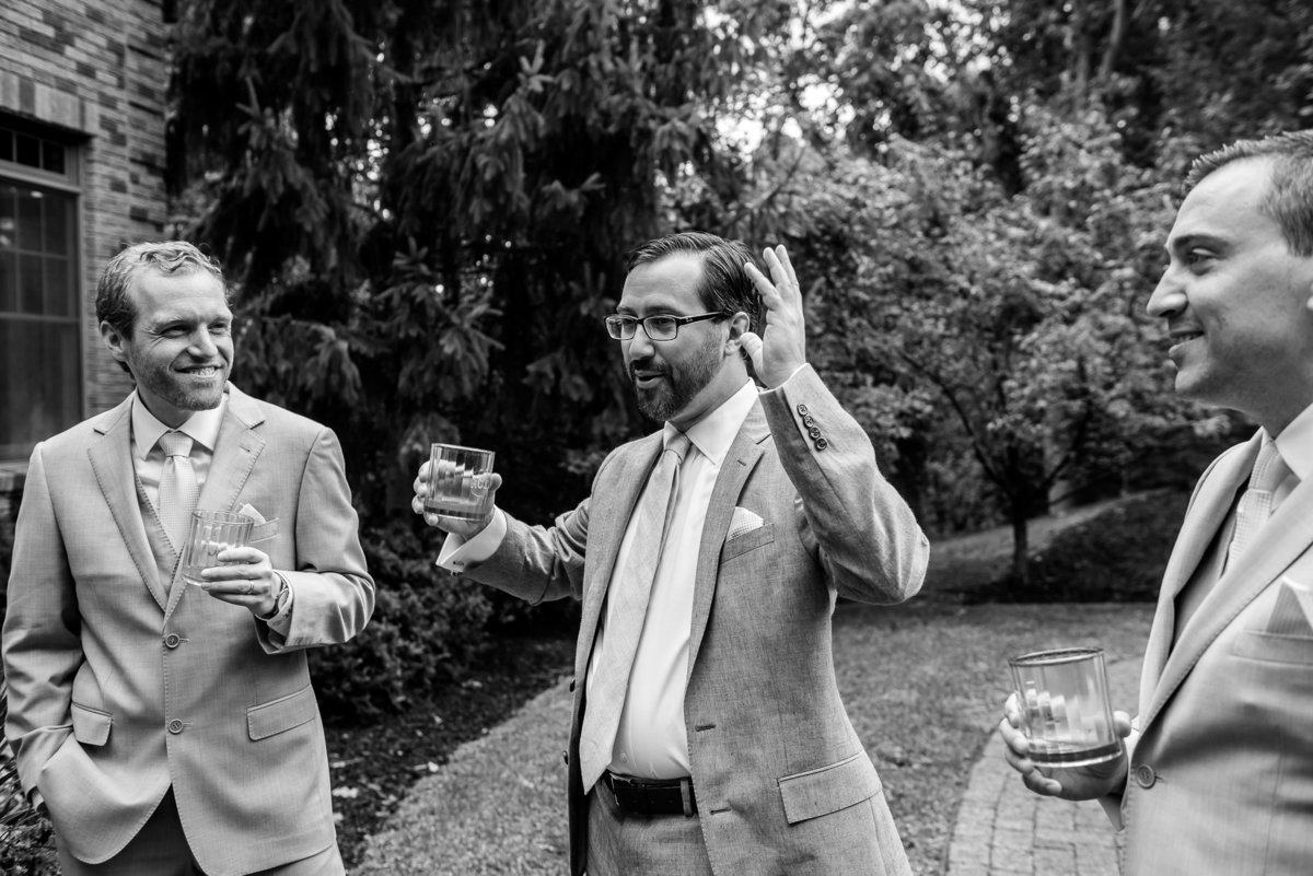Brooklyn Wedding Photographer | Rob Allen Photography | Destination Wedding Photographer at Mt. Sinai New York groom telling stories to groomsmens