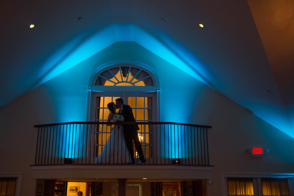bride and groom on balcony at The Riverhouse