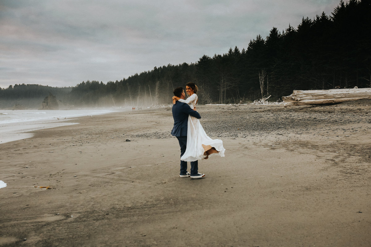 Bride and groom have their first dance during their elopement in Forks Washington at La Push beach.