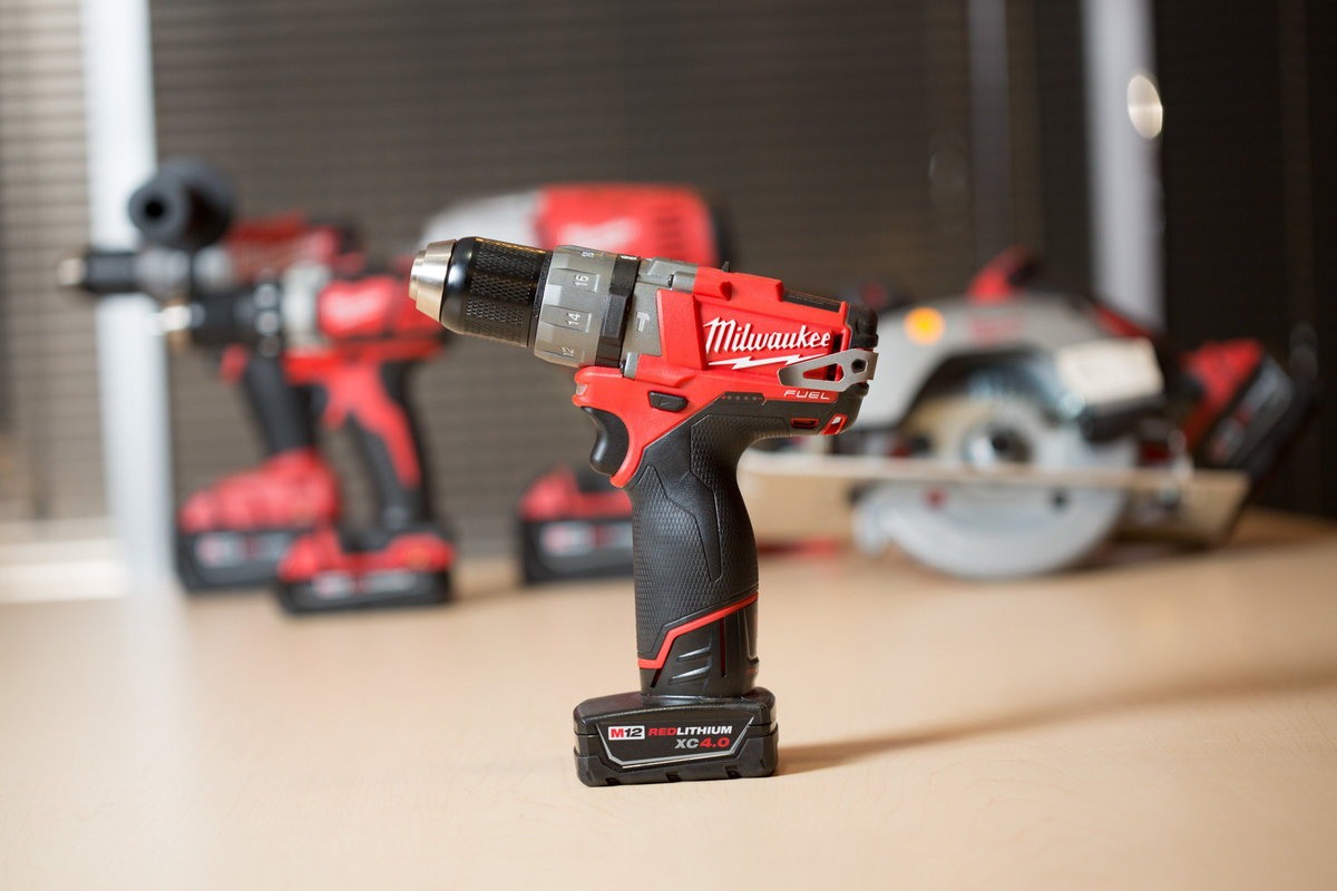 Promo shot of a red, handheld automated drill. Photo by Ross Photography, Trinidad, W.I..