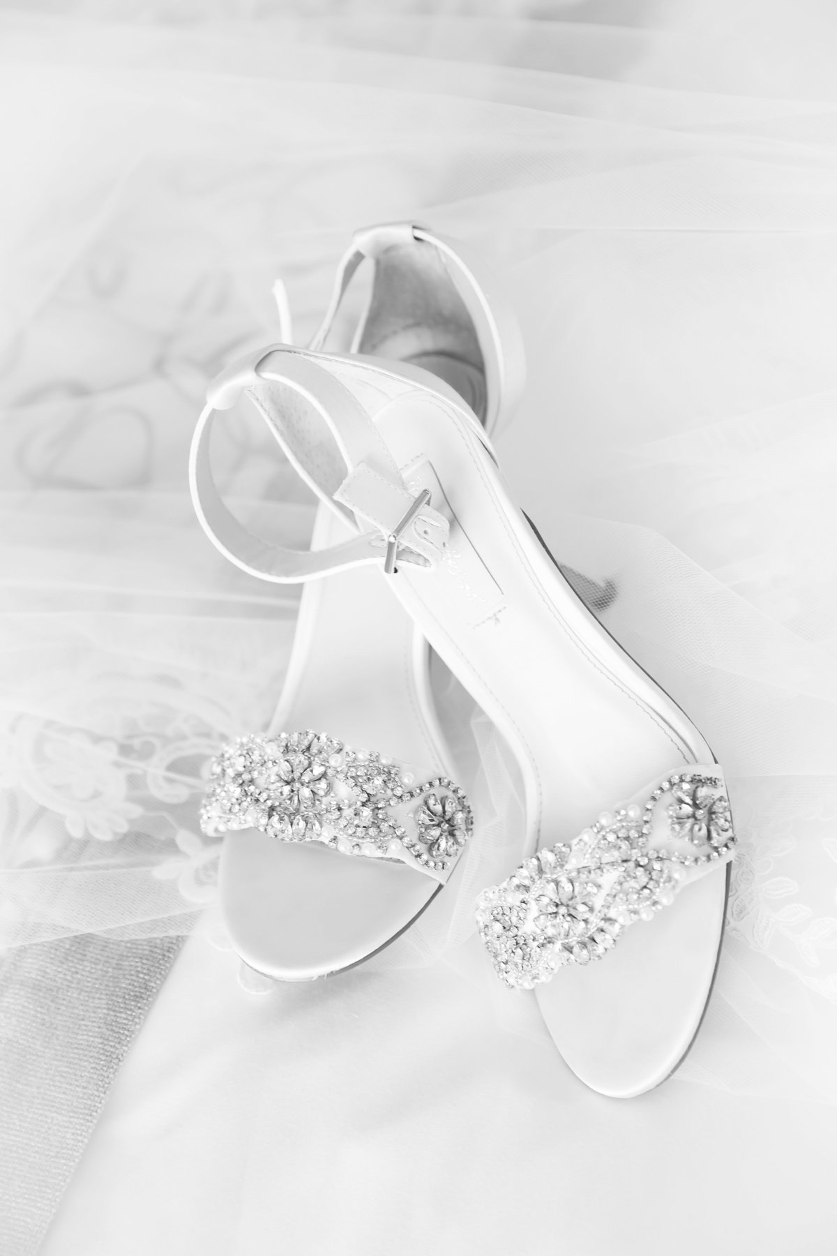Black and white photo of brides classic shoes for wedding day